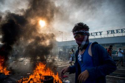 Refugees riot at Serbian border